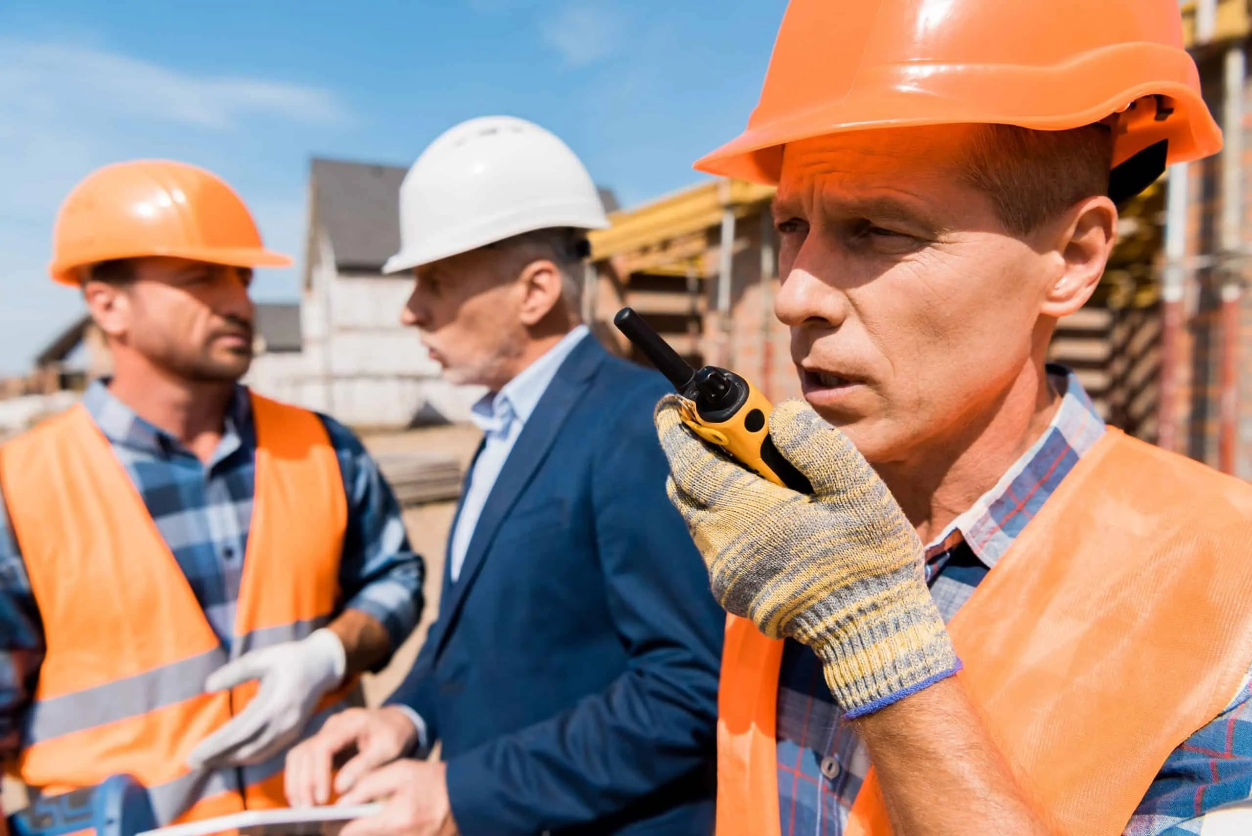 Construction Worker Using a Walkie Talkie