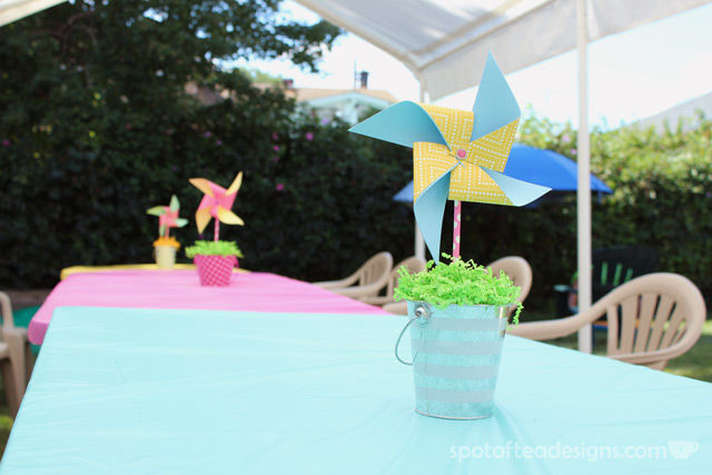 Pinwheel first birthday party: DIY Pinwheel Centerpieces with Pool Noodle as foam center. #birthdayparty   spotofteadesigns.com