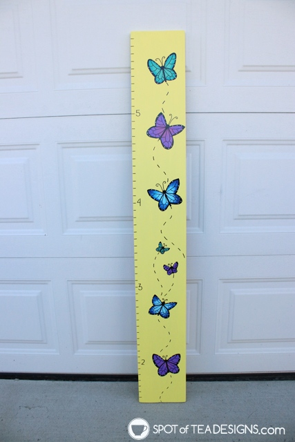 DIY portable growth chart with a hand painted butterfly design | spotofteadesigns.com