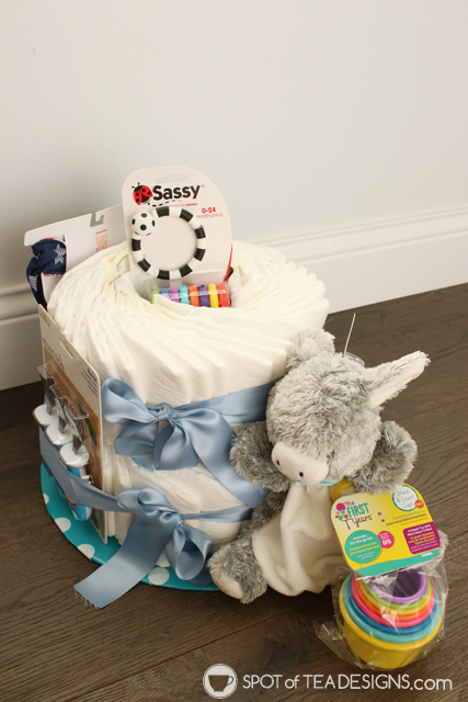 How to make a diaper cake for a baby shower without rollling diapers and using rubber bands | spotofteadesigns.com