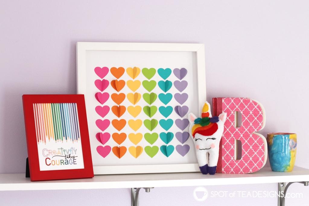 Girl's bright and colorful bedroom tour - rainbow bookshelf art | spotofteadesigns.com