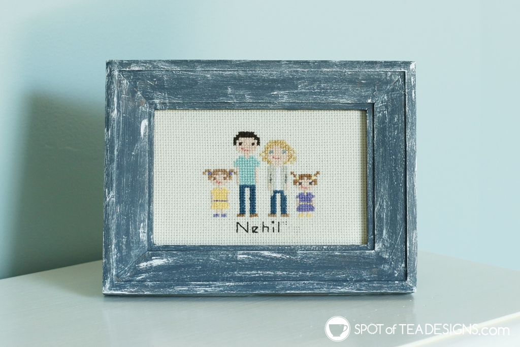 Stitch people frame on entryway table   spotofteadesigns.com