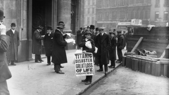 45 Newspaper boy Ned Parfett sells copies of the Evening News telling of the Titanic maritime disaster, London, 16 April 1912