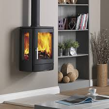 The NEO 3W has been designed to be wall mounted bringing a new dimension to contemporary real fire heating. With a simple to use single air control and an easy to empty ashpan which slides towards you to enable the lid to be fitted and then lift the ashpan out and carry outside safe in the knowledge the ashes are safely contained and won't blow about in the wind, the NEO has been designed for ease of use. The large glass door is kept clean by a powerful airwash system to give excellent views of the fire. The NEO 3W also has side glasses to give a more panoramic view of the flames. The NEO benefits from DEFRA approval allowing you to burn wood in smoke controlled areas. Supplied as standard with a multifuel grate you can also burn smokeless fuels allowing you greater choice when it comes to chosing which fuel to burn. A wood grate is available as an extra.