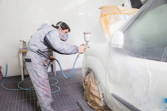 Car Body Painter Spraying Paint