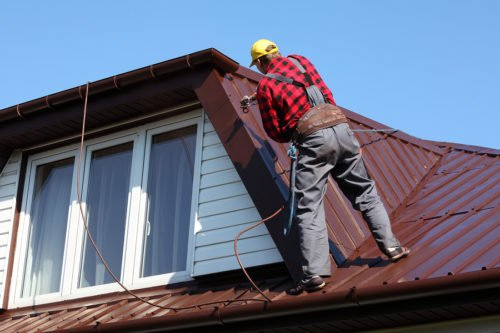 painting a roof with a titan sprayer