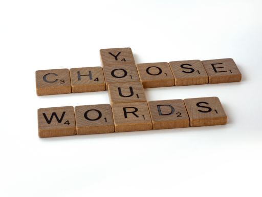"Photo of brown blocks with letters spelling out the phrase ""Choose Your Words,"" because words matter for life."