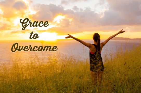Grace to Overcome -- Photo of woman standing in a field with her arms raised in the light of a beautiful sunrise.