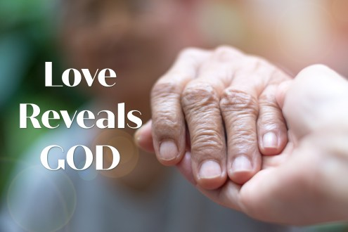Photo of one person taking hold of the hand of another. For this blog post the photo represents the hand of God. God is love and Love reveals God.
