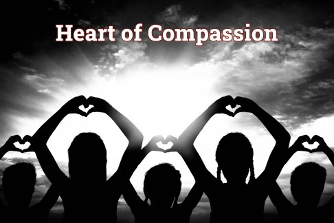 Children making a heart with their hands just above their heads. Photo represents a heart of compassion.