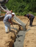 Pedro and his crew directing the footer pour