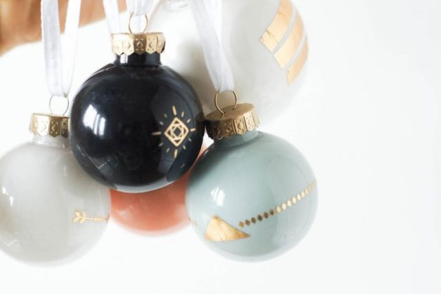 DIY tattooed christmas ornaments using gold summer metallic temporary tattoos!