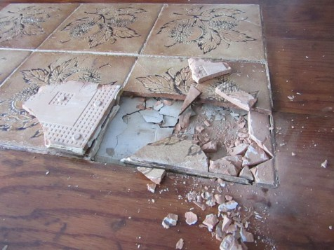 Once the first tile was broken and a chunk removed, it was really easy to remove the rest of the tile.