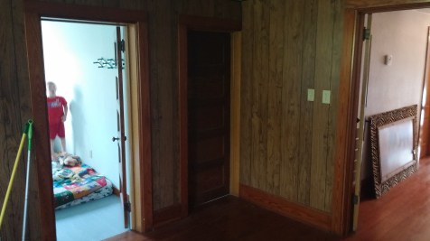 "The door on the left leads to what used to be Peanut's bedroom, but is now an office for Scott. The door in the middle leads to the ""laboratory."""