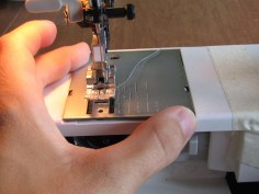 Replace the throat plate and close your bobbin housing when you are complete