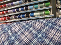 Hold your bolt of fabric up to the threads to quickly find a good match for your next project.
