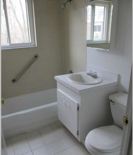 Bathroom with white vanity and walls.