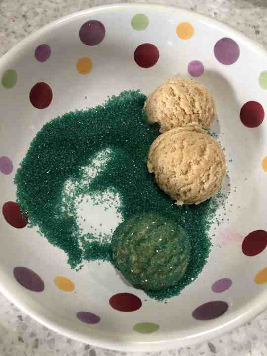 Covering snickerdoodle cookies in colored sugar