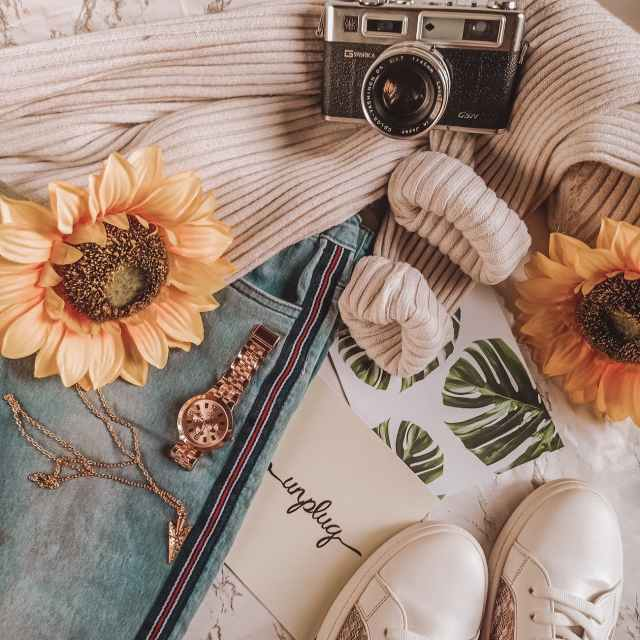 retro camera with flowers accessories and clothes