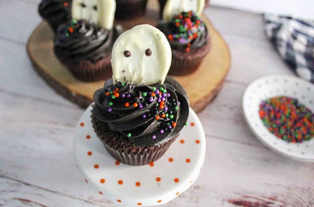 chocolate ghost cupcake on stand