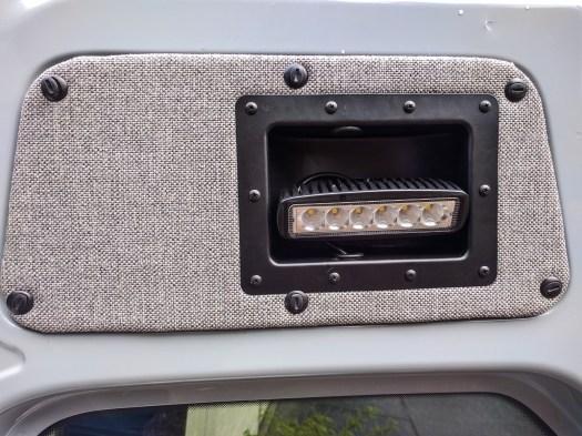 Lights mounted in repurposed amp case handles in rear doors