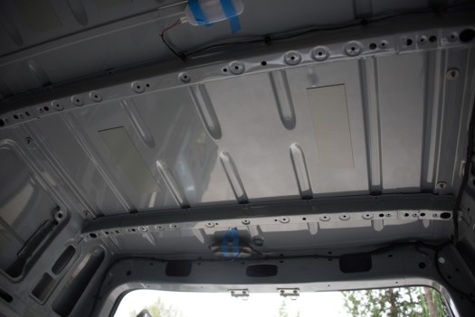 The ceiling location at the back of the van where the fan will go.