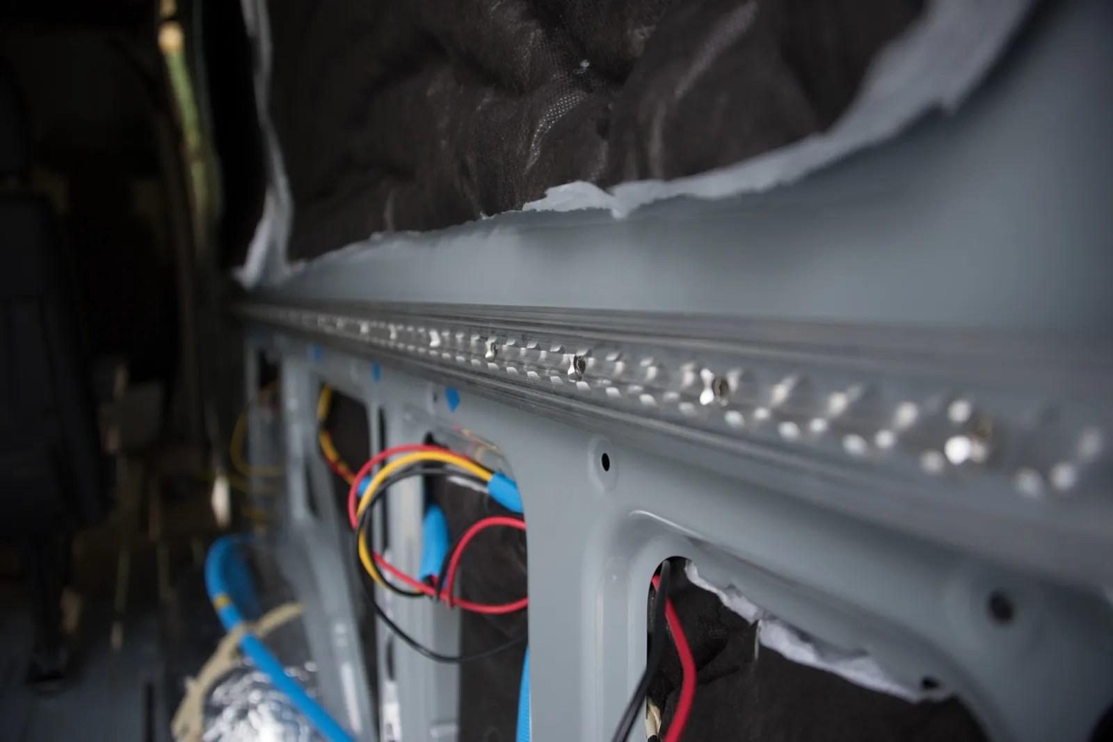Aluminum l-track makes a reconfigurable tie-down system