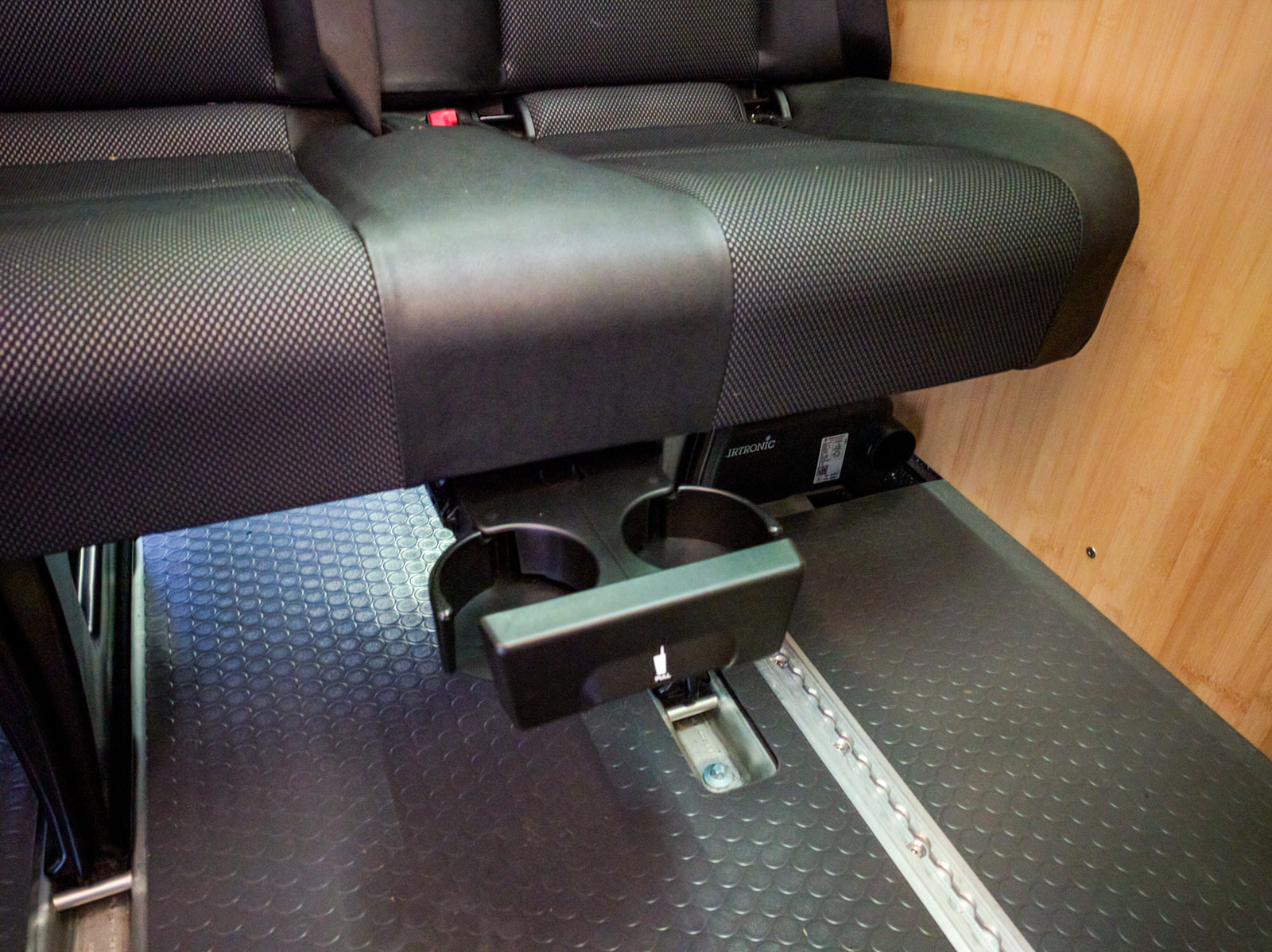Cupholder under the passenger bench seat
