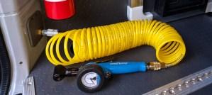 Tire inflator inside back door pillar