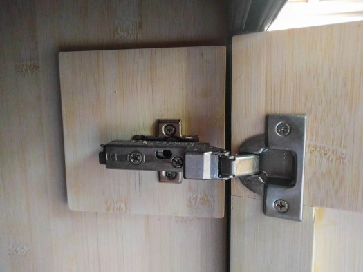 """Close-up of door hinge mounting area with second layer of 1/4"""" ply to provide attachment point"""