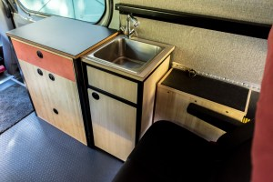 Hot water tank (next to seat), sink cabinet, sliding door cabinet
