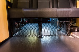 Cargo net under bench seat to hold plastic storage tubs in place