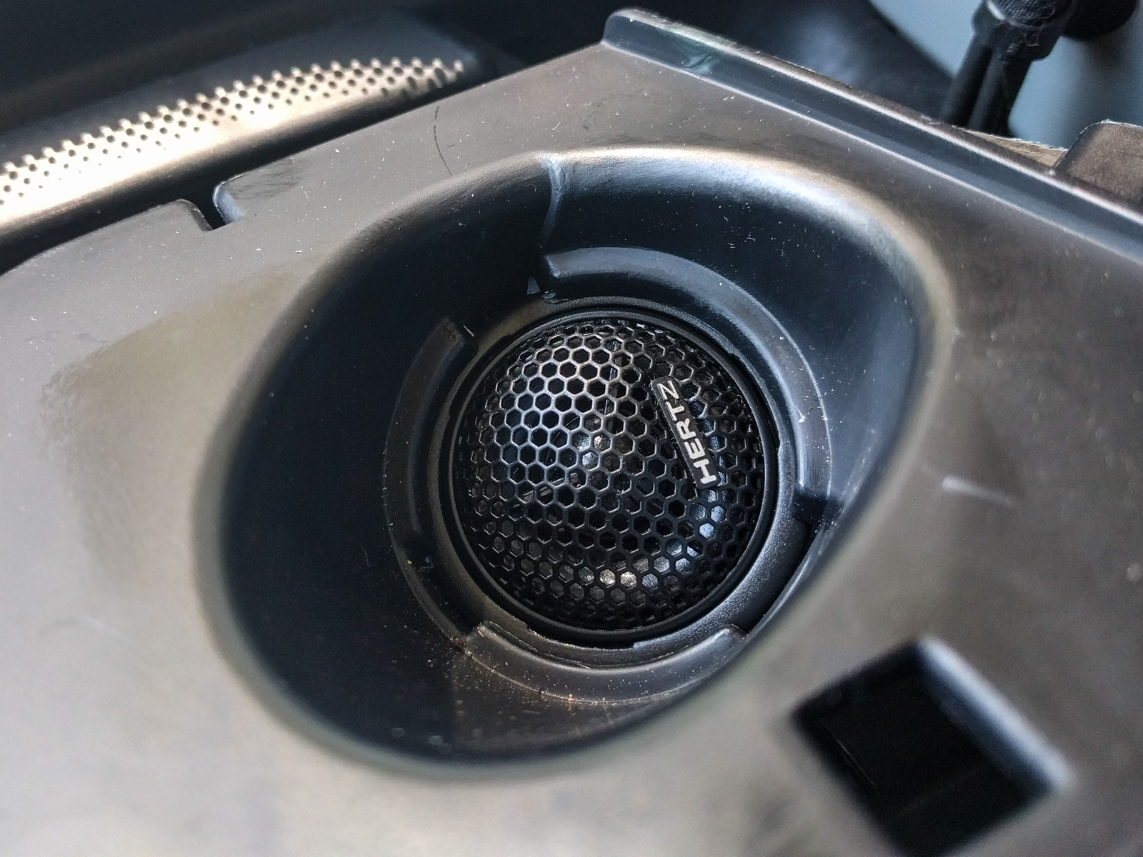 Pull the tweeter wire through to the underside of the tweeter surround,  then crimp on