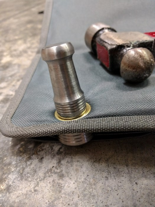 Punching a grommet into the organizer