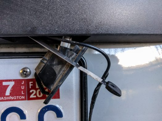 using a wire fish to pull the cable from the inside of the trim to the inside of the rear door