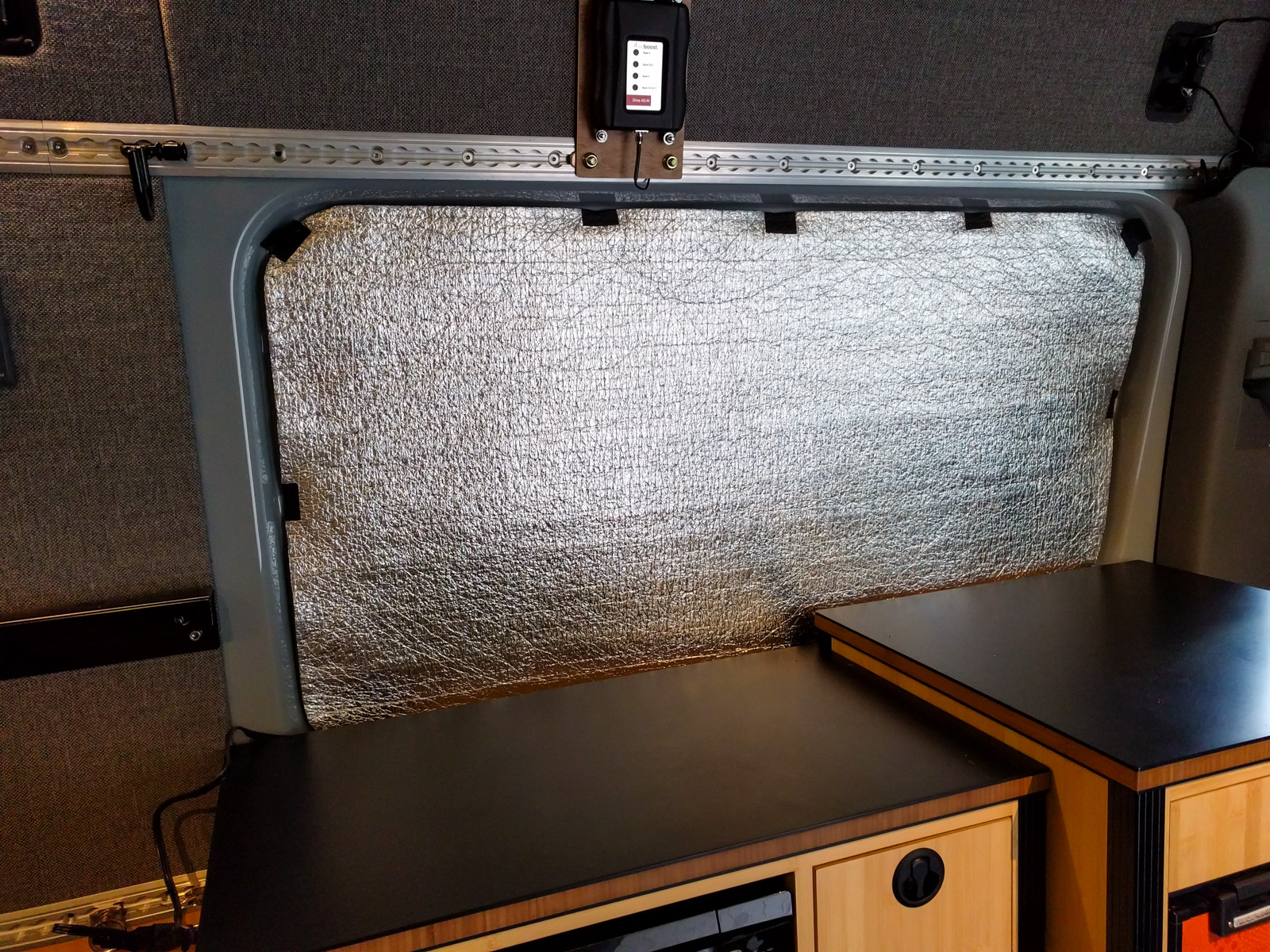 Low-E foil-faced foam window covers insulate and cut out the light