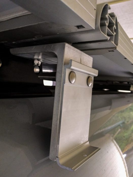 How the brackets attach to the VanTech roof rack t-slots