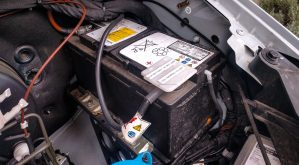 Auxiliary battery under the hood of a Sprinter