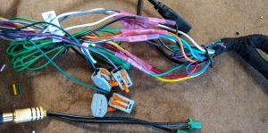 Aftermarket stereo cable wiring harness construction