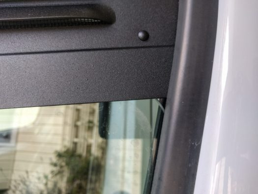 The rear corner of the glass is curved in a way that leaves a gap at the back top corner.