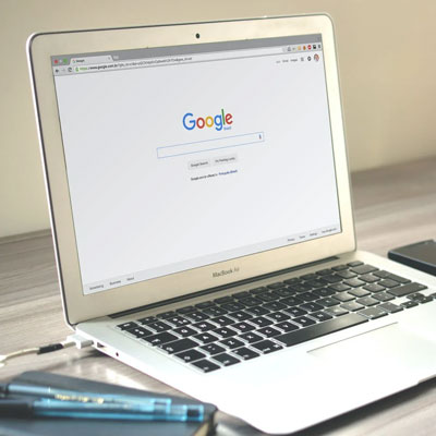 Image of a laptop displaying google.com.