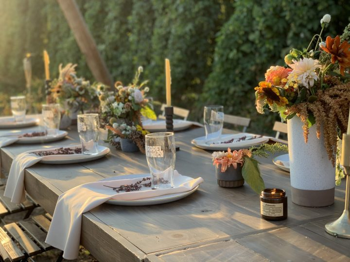 Gorgeous table decorated by Kelsie Stevens, Janna Smith and flowers by Leaning Barn Farms. All the details you could ever want for a beautiful outdoor dinner. For more travel posts be sure to follow me at www.sprouting-vitality.com or on instagram sproutingvitality. #mckenzieonthemove