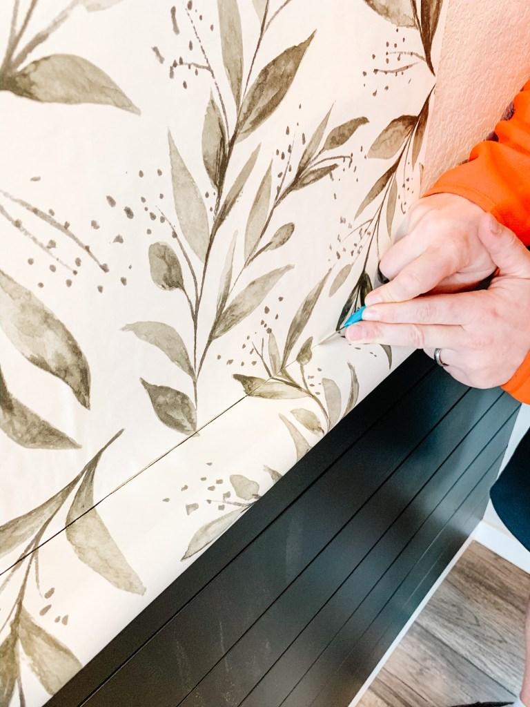 hand cutting wallpaper