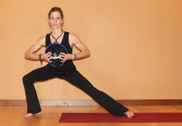 Woman demonstrating lunge.
