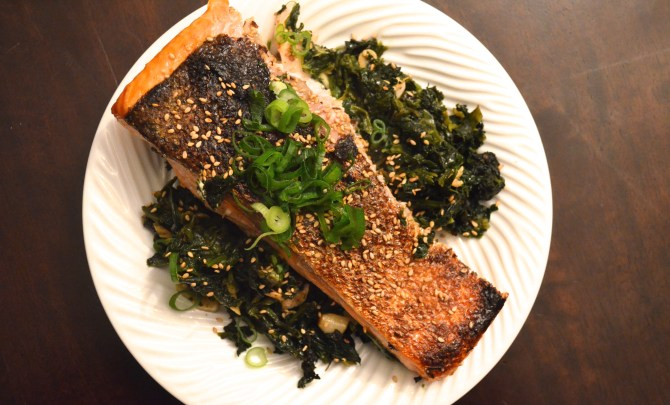 crisp salmon on sesame spinach