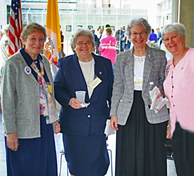 Sisters Betty Hopf (Saint Mary-of-the-Woods), Marie Denis Lucey (Washington, D.C), Mary Catherine Guiler (Washington, D.C.) and Jean Kenny (Chicago) catch up on things at the reception.