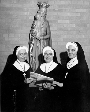 Left to right, Sisters Kathleen Therese O'Connor (RIP), Monica Withem (RIP) (Sister Patricia Ann) and Agnes Veronica Hester (RIP) prepare to leave for Peru in March 1963.