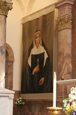 A large banner of Mother Theodore Guerin, which hung in St. Peter's Square during the beatification ceremony in Rome, was hung in the Church of the Immaculate Conception.