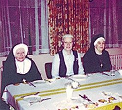 Getting ready to partake of a Thanksgiving meal in the early 1980s at St. Joseph Convent, Quincy, Mass., are Sisters Mary Benita Taylor (RIP), Eileen Mary Cunningham (RIP) and Regina Garrity (RIP).