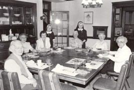 Retired sisters at St. Joseph Convent in Quincy, Mass., get ready to celebrate Thanksgiving in 1992 with former General Superior Sister Nancy Nolan. Pictured from left are Sisters Kevin Cafferty (RIP), Mary Loyola Bender, Nancy Nolan, Alma Marie Earus (RIP), Eileen Mary Cunningham (RIP), Patricia Marie Woods (RIP), Ann Veronica Wall (RIP) and Esther Marie Sullivan (RIP).